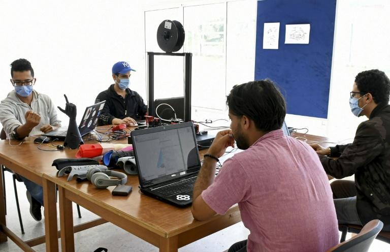 Tunisian engineers test a prototype of an artificial hand, which they hope will be produced at a lower price than existing prostheses