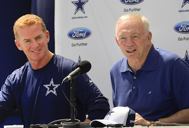 """Dallas Cowboys head coach Jason Garrett, left, and owner Jerry Jones, right, speak at the """"State of the team"""" news conference during NFL football training camp on Wednesday, July 23, 2014, in Oxnard, Calif. (AP Photo/Gus Ruelas)"""