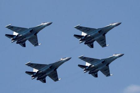 FILE PHOTO: Sukhoi Su-35 multi-role fighters of the Sokoly Rossii aerobatic team fly in formation during a demonstration flight at the MAKS 2017 air show in Zhukovsky