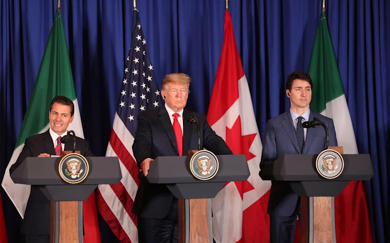 President Donald Trump, center, Canada's Prime Minister Justin Trudeau, right, and Mexico's President Enrique Pena Nieto hold a joint news conference before signing a new United States-Mexico-Canada Agreement that is replacing the NAFTA trade deal, during a ceremony at a hotel before the start of the G20 summit in Buenos Aires, Argentina, Friday, Nov. 30, 2018. The USMCA, as Trump refers to it, must still be approved by lawmakers in all three countries. (AP Photo/Martin Mejia)