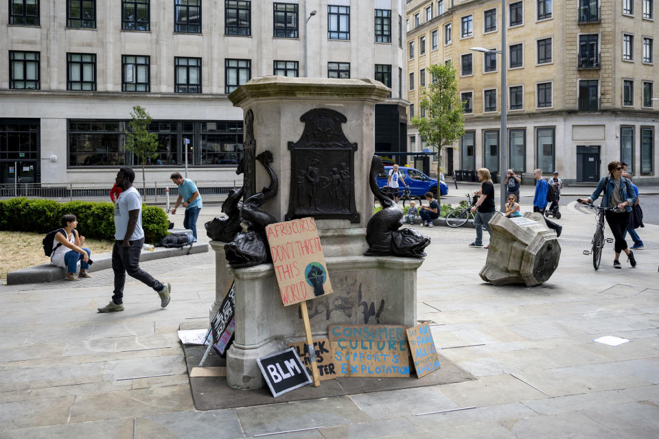 "BRISTOL, ENGLAND - JUNE 08: A general view of the Edward Colston statue plinth on June 8, 2020 in Bristol, England. Yesterday, protesters in Bristol toppled the statue of Edward Colston, a 17th-century slave-trader, and tossed it into the harbour. Outside the Houses of Parliament in London, a statue of former Prime Minister Winston Churchill was spray-painted with the words ""was a racist"" amid anti-racism protests over the weekend. (Photo by Matthew Horwood/Getty Images)"