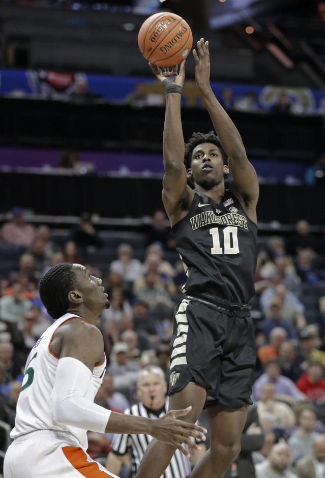Wake Forest's Jaylen Hoard (10) shoots over Miami's Ebuka Izundu (15) during the first half of an NCAA college basketball game in the Atlantic Coast Conference tournament in Charlotte, N.C., Tuesday, March 12, 2019. (AP Photo/Nell Redmond)