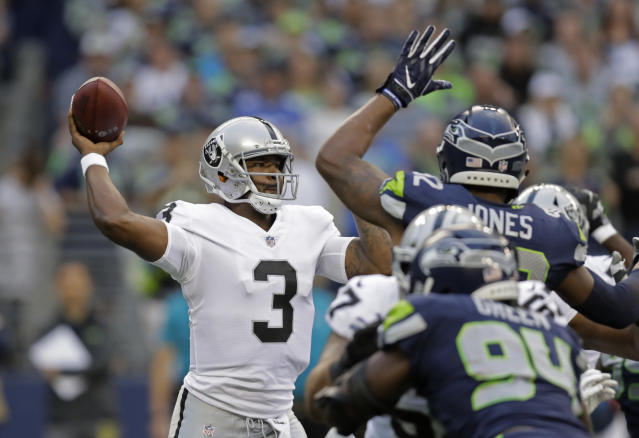 Oakland Raiders quarterback EJ Manuel passes against the Seattle Seahawks during the first half of an NFL football preseason game, Thursday, Aug. 30, 2018, in Seattle. (AP Photo/Stephen Brashear)