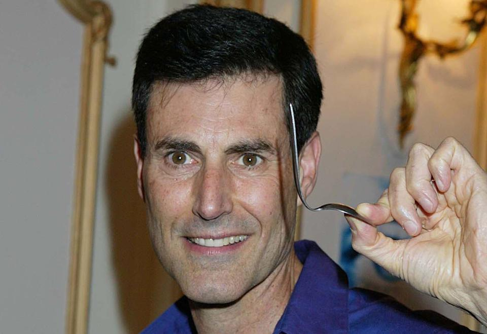 Geller pictured with his bent spoon in 2003 (PA Images)