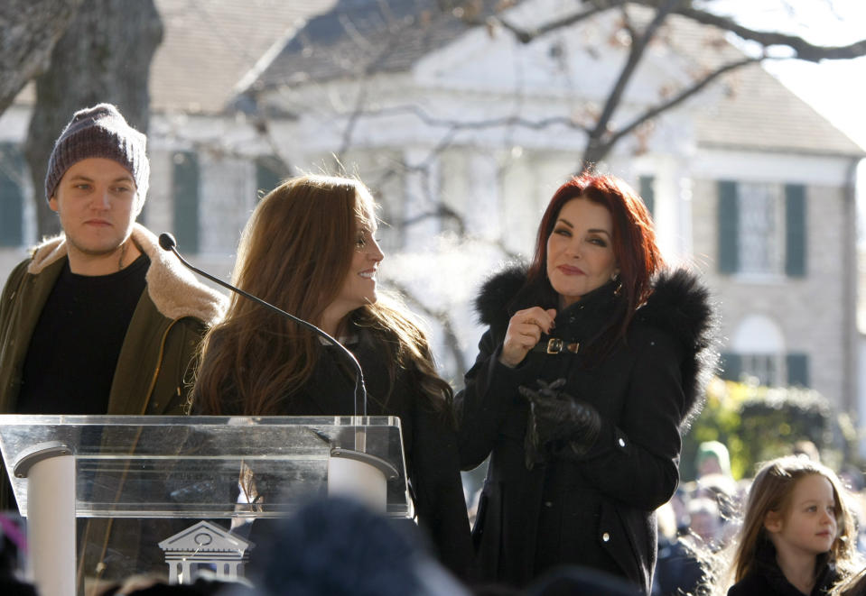 Priscilla Presley (right), Lisa Marie Presley (center) and Ben Keough during a proclamation of Elvis Presley Day by Memphis and Shelby County officials at Graceland in Memphis, Tennessee on Jan. 8, 2015.