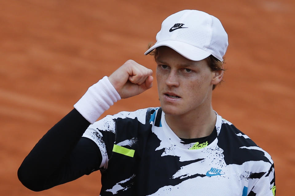 Italy's Jannik Sinner celebrates winning his fourth round match of the French Open tennis tournament against Germany's Alexander Zverev in four sets, 6-3, 6-3, 4-6, 6-3, at the Roland Garros stadium in Paris, France, Sunday, Oct. 4, 2020. (AP Photo/Christophe Ena)