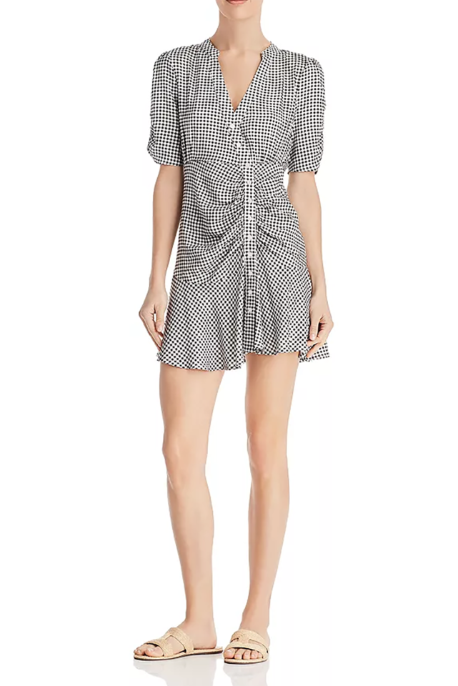 "<p><strong>En Créme</strong></p><p>bloomingdales.com</p><p><strong>$88.00</strong></p><p><a href=""https://www.bloomingdales.com/shop/product/en-creme-asymmetric-gingham-dress?ID=3273077"" target=""_blank"">SHOP IT </a></p><p>This dress is a more contemporary take on gingham thanks to its asymmetric hemline and ruching across the bodice. It's perfect for both day and night occasions. For instance, a pair of black high-heel sandals will create that cute date-night look while a simple pair of brown slides will tone it down for a casual morning. </p>"