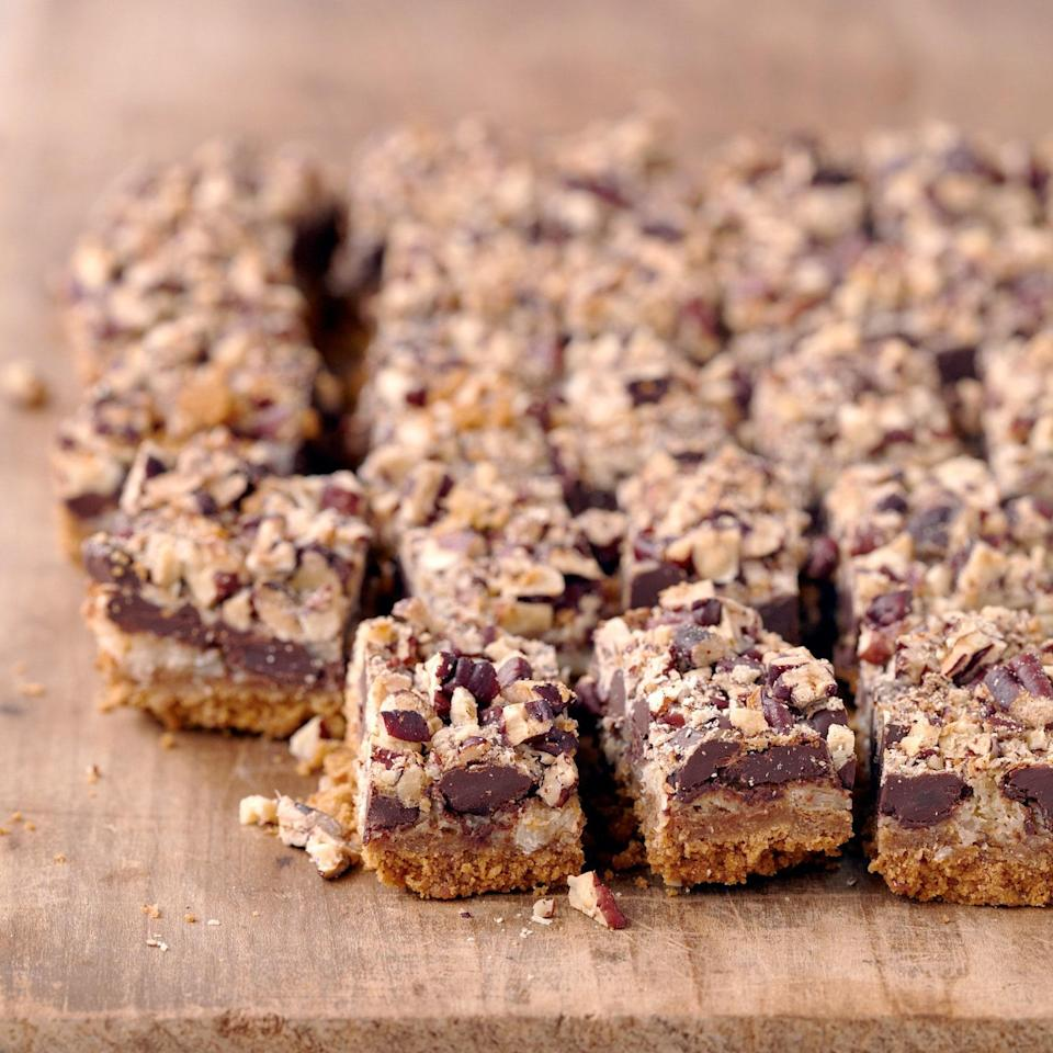 """These classic graham cracker-based bar cookies are a nostalgic favorite. Feel free to substitute milk chocolate, white chocolate, butterscotch, or bittersweet chocolate chips for the semi-sweet chocolate chips. <a href=""""https://www.epicurious.com/recipes/food/views/five-layer-bars-367589?mbid=synd_yahoo_rss"""" rel=""""nofollow noopener"""" target=""""_blank"""" data-ylk=""""slk:See recipe."""" class=""""link rapid-noclick-resp"""">See recipe.</a>"""