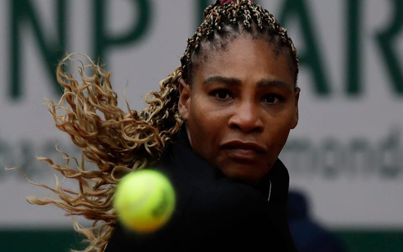 Serena Williams of the U.S. eyes the ball as she plays a shot against Kristie Ahn of the U.S. in the first round match of the French Open tennis tournament at the Roland Garros stadium in Paris - AP Photo/Alessandra Tarantino