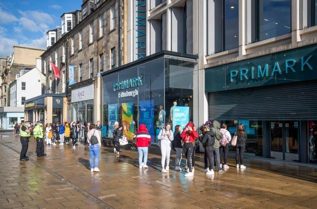People queue outside a Primark store