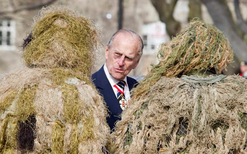 The Duke of Edinburgh speaks to sniper team members of 3rd Battalion of The Royal Canadian Regiment at Queen's Park in Toronto - Credit: REUTERS/Fred Thornhill