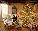 """<p>Casually draped around the Christmas tree, a garland of wide ribbon—three inches is best!—adds softness with a golden touch. Adding a ribbon garland is easy to do. Just start at the top and wind your way around the tree, loosely going over and under branches along the way. </p><p>Prefer a primarily red, white, or even blue tree? Use ribbon garland in your favorite color to establish the color palette and tie all your tree decorations together. </p><p><a class=""""link rapid-noclick-resp"""" href=""""https://www.amazon.com/Ben-Collection-Single-Ribbon-Antique/dp/B077QQK3KS/ref=sr_1_10?tag=syn-yahoo-20&ascsubtag=%5Bartid%7C10050.g.28703522%5Bsrc%7Cyahoo-us"""" rel=""""nofollow noopener"""" target=""""_blank"""" data-ylk=""""slk:SHOP SATIN RIBBON"""">SHOP SATIN RIBBON</a></p>"""