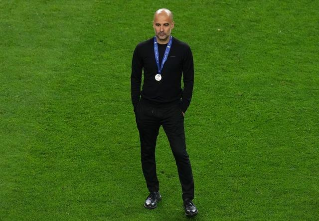 Guardiola looked on as Chelsea celebrated their success
