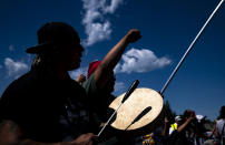 """Roy Broncheau, aka Walks Through Hail, plays the drum and sings during a march, on Monday, June 7, 2021, in Clearwater County, Minn. More than 2,000 Indigenous leaders and """"water protectors"""" gathered in Clearwater County from around the country to protest the construction of Enbridge Line 3. The day started with a prayer circle and moved on to a march to the Mississippi headwaters where the oil pipeline is proposed to be built. (Alex Kormann/Star Tribune via AP)"""