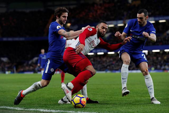 "Soccer Football - Premier League - Chelsea vs West Bromwich Albion - Stamford Bridge, London, Britain - February 12, 2018 West Bromwich Albion's Matt Phillips in action with Chelsea's Cesc Fabregas and Davide Zappacosta Action Images via Reuters/Andrew Couldridge EDITORIAL USE ONLY. No use with unauthorized audio, video, data, fixture lists, club/league logos or ""live"" services. Online in-match use limited to 75 images, no video emulation. No use in betting, games or single club/league/player publications. Please contact your account representative for further details."