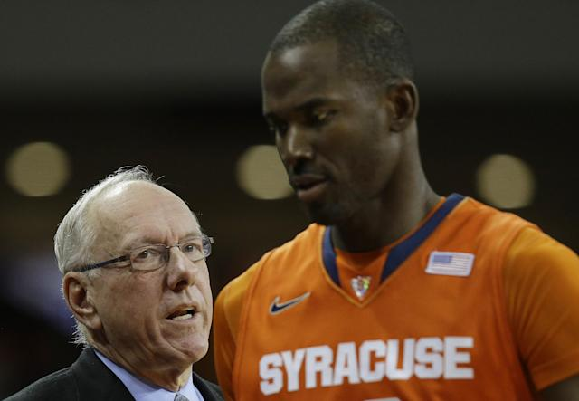 Syracuse head coach Jim Boeheim talks to Baye-Moussa Keita as he sits down during the first half of an NCAA college basketball game against Boston College in Boston, Monday, Jan. 13, 2014. (AP Photo/Stephan Savoia)