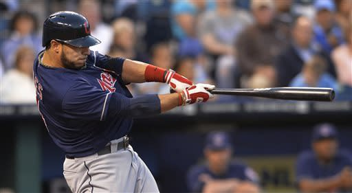 Cleveland Indians' Mike Aviles connects on this for a three-run home run in the third inning of their second baseball game against the Kansas City Royals, Sunday, April 28, 2013, in Kansas City, Mo. (AP Photo/Reed Hoffmann)
