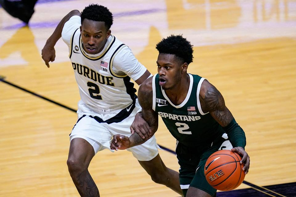 Michigan State guard Rocket Watts, right, drives on Purdue guard Eric Hunter Jr. during the first half of an NCAA college basketball game in West Lafayette, Ind., Tuesday, Feb. 16, 2021. (AP Photo/Michael Conroy)