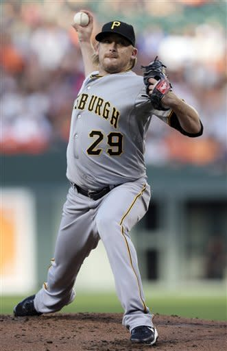 Pittsburgh Pirates starting pitcher Kevin Correia throws to the Baltimore Orioles in the first inning of a baseball game in Baltimore, Wednesday, June 13, 2012. (AP Photo/Patrick Semansky)