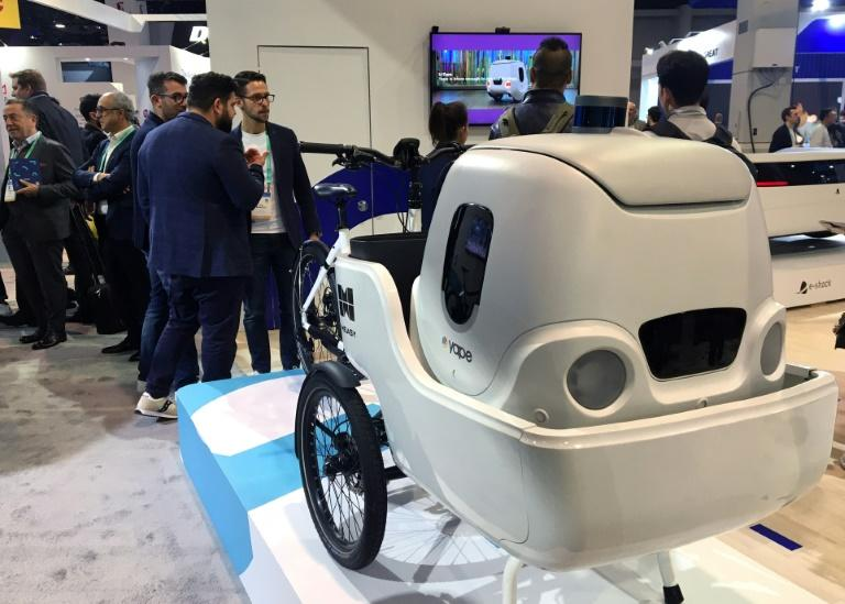 An electric cargo bike from Italian startup Measy uses a delivery robot from sister company Yape for multimodal transportation at the 2020 Consumer Electronics Show (AFP Photo/Robert LEVER)