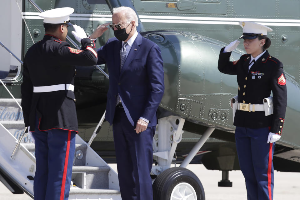 President Joe Biden returns a salute with a Marine Corp honor guard as he disembarks Marine One before boarding Air Force One, Friday, Sept. 3, 2021, at Andrews Air Force Base, Md. (AP Photo/Luis M. Alvarez)