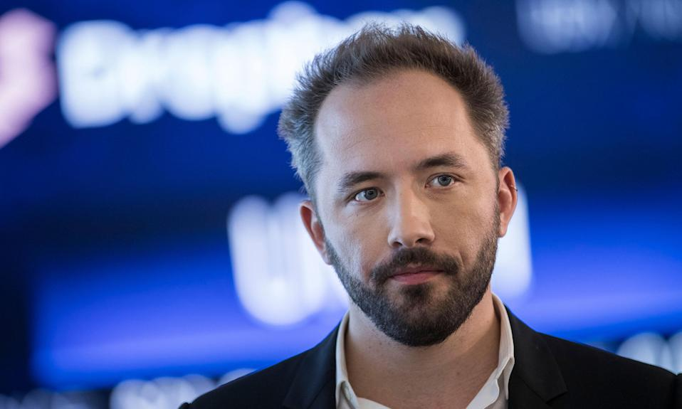 NEW YORK, NY - MARCH 23: Dropbox CEO Drew Houston monitors computer screens as trading starts on Dropbox's initial public offering at Nasdaq MarketSite, March 23, 2018 in New York City. Dropbox, a cloud storage provider, opened at $29 a share. (Photo by Drew Angerer/Getty Images)