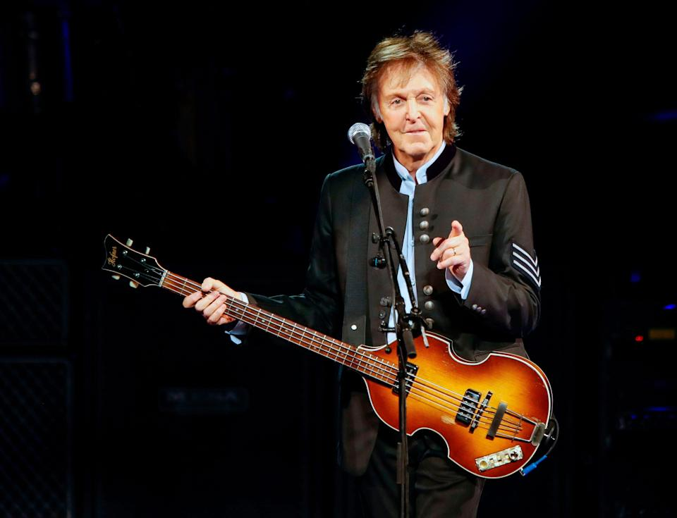 In this file photo taken on July 27, 2017 Paul McCartney performs in concert during his One on One tour at Hollywood Casino Amphitheatre in Tinley Park, Illinois. - Paul McCartney has been confirmed on November 19, 2019 as the headline act at Glastonbury music festival.