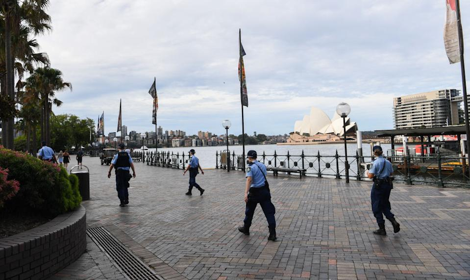 NSW Police patrol Circular Quay near the Sydney Opera House.