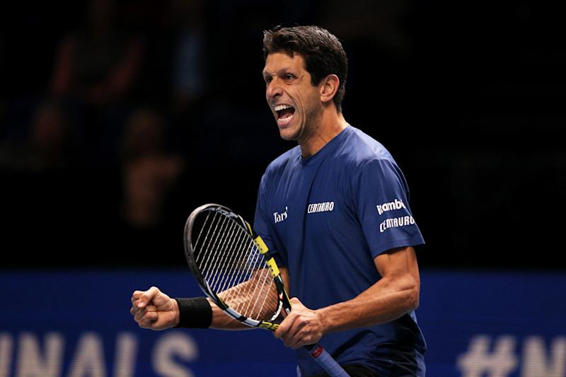 LONDON, ENGLAND - NOVEMBER 14: Marcelo Melo of Brazil, playing partner of Lukasz Kubot of Poland celebrates match point in his doubles match against Joe Salisbury of Great Britain and Rajeev Ram of the USA during Day Five of the Nitto ATP Finals at The O2 Arena on November 14, 2019 in London, England. (Photo by James Chance/Getty Images)