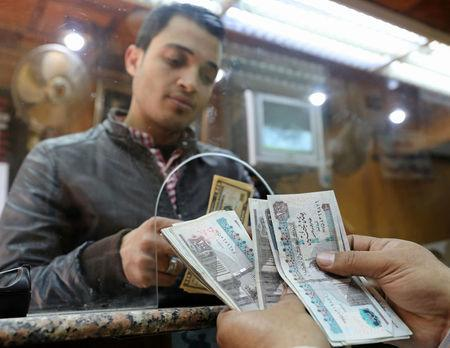 A Customer Exchanges U S Dollars To Egyptian Pounds In Foreign Exchange Office Central Cairo
