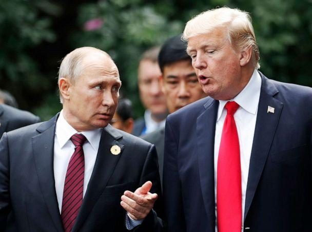 PHOTO: President Donald Trump and Russia's President Vladimir Putin talk as they make their way to take the 'family photo' during the Asia-Pacific Economic Cooperation (APEC) leaders' summit in the central Vietnamese city of Danang on November 11, 2017. (Jorge Silva/AFP via Getty Images)