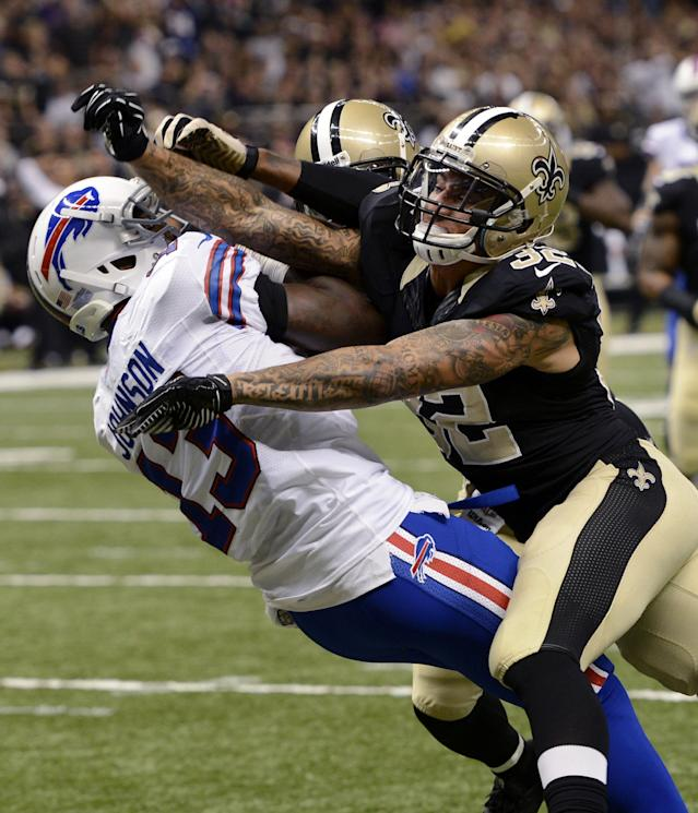 Buffalo Bills wide receiver Steve Johnson (13) pulls in a touchdown reception in front of New Orleans Saints strong safety Kenny Vaccaro (32) and free safety Malcolm Jenkins during the first half of an NFL football game in New Orleans, Sunday, Oct. 27, 2013. (AP Photo/Bill Feig)