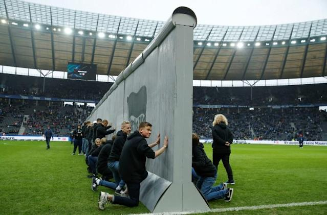 A symbolic wall, bearing the inscrition 'Against Walls together with Berlin', was set up across the pitch before the start of Hertha Berlin's match agaomst Leipzig at the Olymic Stadium in Berlin on Saturday (AFP Photo/Odd Andersen)