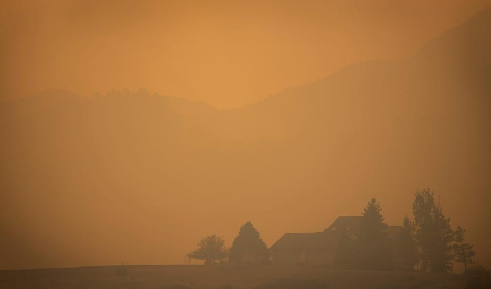 Smoke from the Cameron Peak Fire, the largest wildfire in Colorado history, fills the air in a valley near Masonville, Colo. on Saturday, Oct. 17, 2020.