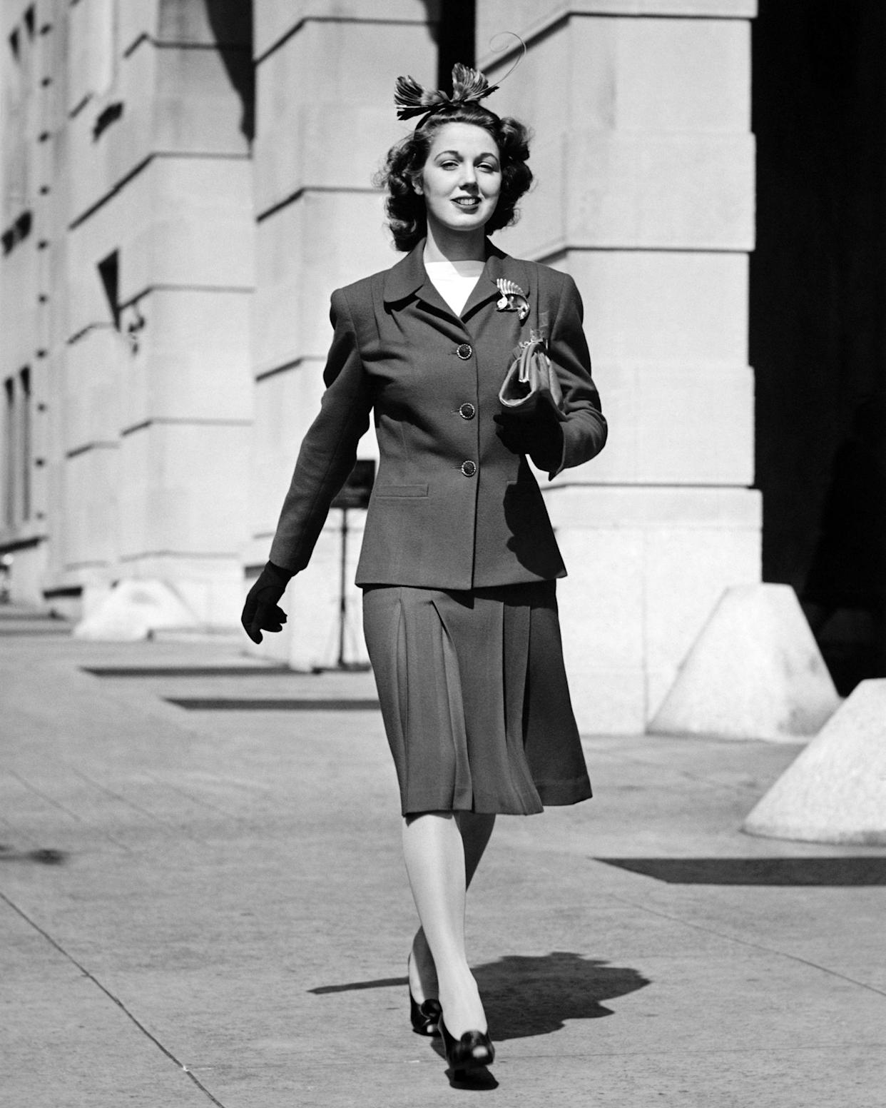 1930s woman wearing a suit with shoulder pads