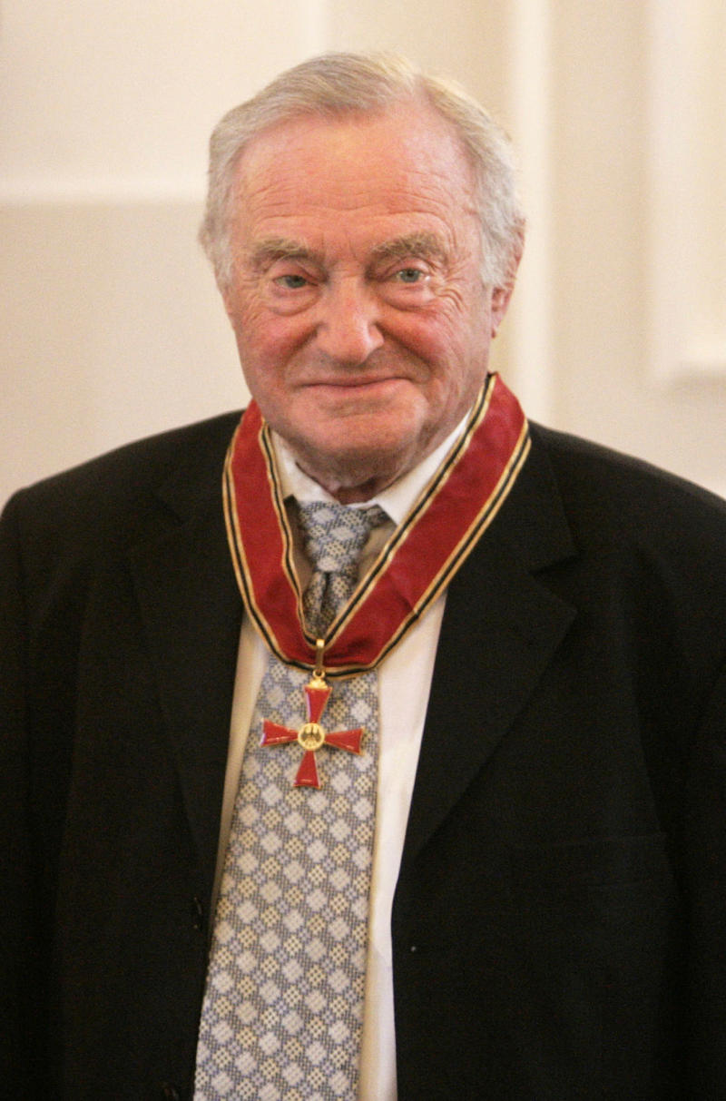 FILE - In this June 15, 2006 file photo, Noach Flug, president of the Auschwitz committee, poses during a ceremony at which he was honored for his life's work with Germany's Grand Order of Merit, at the Bellevue presidential palace in Berlin. Flug, a tireless advocate for Holocaust survivors who successfully fought for larger government stipends for the aging and dwindling population, died on Thursday Aug. 11, 2011.  He was 86. (AP Photo/Jan Bauer, File)