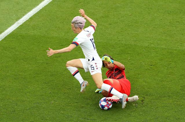 Megan Rapinoe of the USA is challenged by Sarah Bouhaddi of France during the 2019 FIFA Women's World Cup France Quarter Final match between France and USA at Parc des Princes on June 28, 2019 in Paris, France. (Photo by Robert Cianflone/Getty Images)