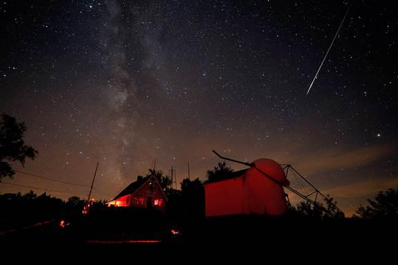 A bright Perseid meteor streaks over the Stellafane observatory in Springfield, Vermont on Aug. 7, 2010 during the Perseid meteor shower.