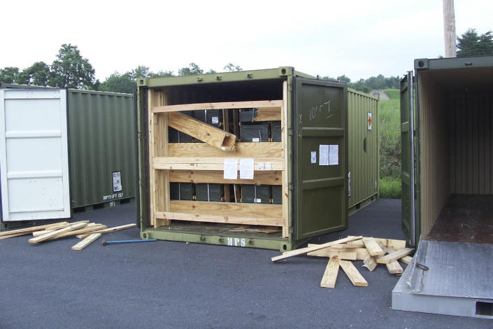 In this July 13, 2017, image provided by the U.S. Army Criminal Investigation Command on Feb. 9, 2021, a storage container of explosive ordnance shows signs of theft after arriving at the Letterkenny Army Depot in Chambersburg, Pa. An ammunition canister containing 32 rounds of 40mm M430A1 grenades, property of the U.S. Marine Corps, was missing. (U.S. Army Criminal Investigation Command via AP)