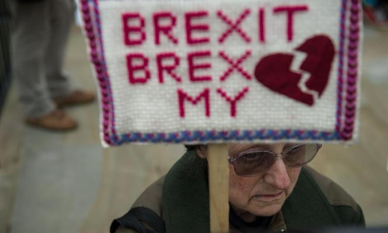 Anti-Brexit protesters demonstrate on Whitehall opposite Downing Street in London