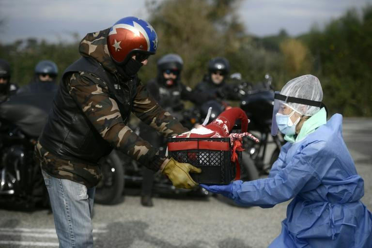 As Italy entered new restrictions, Harley Davidson fans brought Christmas gifts to medical workers in Rome