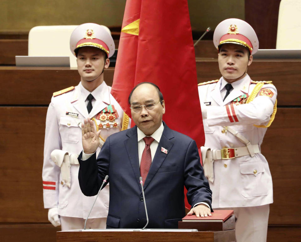 Vietnamese newly elected President Nguyen Xuan Phuc takes an oath in front of the National Assembly in Hanoi, Vietnam on Monday, April 5, 2021. Vietnam's legislature voted Monday to make Pham Minh Chinh, a member of the Communist party's central committee for personnel and organization, the country's next prime minister. Outgoing Prime Minister Nguyen Xuan Phuc was appointed the new president. (Nguyen Trong Duc/VNA via AP)