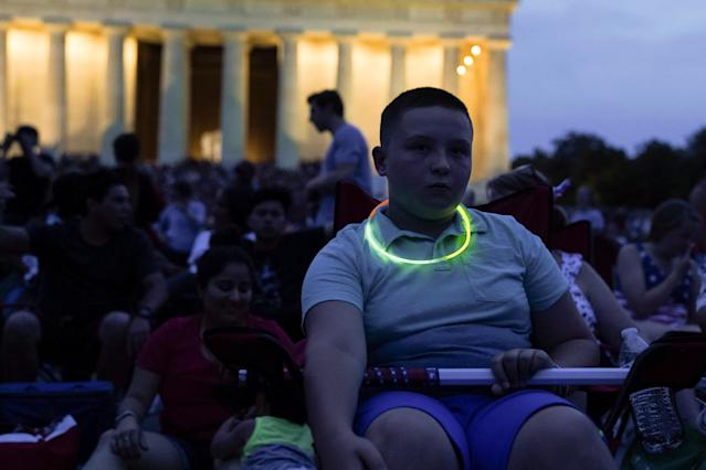 <p>A boy sits near the Lincoln Memorial prior to a firework show during the 4th of July Independence Day celebrations at the National Mall in Washington, D.C.,July 4, 2018. (Photo: Toya Sarno Jordan/Reuters) </p>