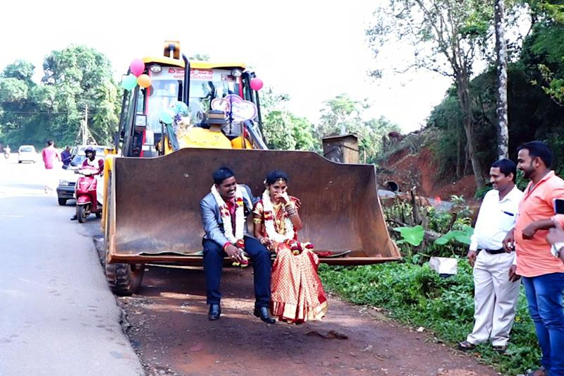 Karnataka Groom Takes his Bride Home Riding a JCB Earthmover