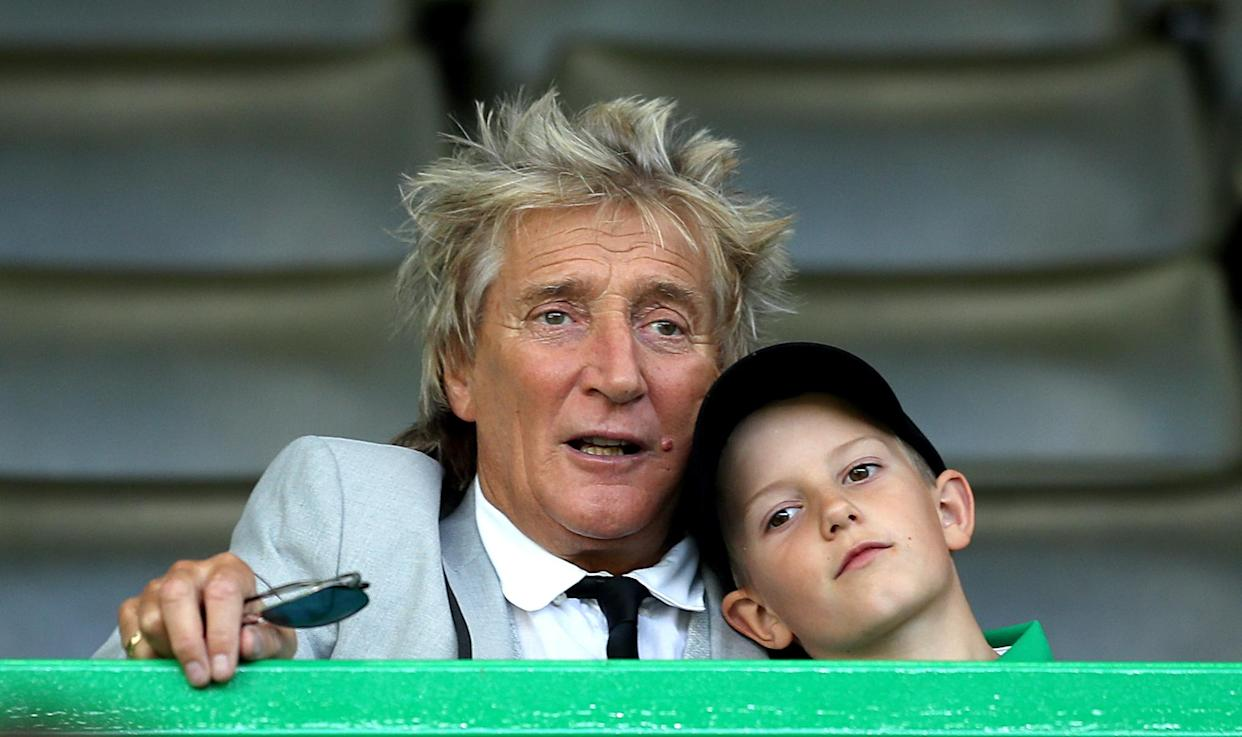 Rod Stewart in the stands with son Aiden during the UEFA Champions League third qualifying round second leg match at Celtic Park, Glasgow. (Photo by Jane Barlow/PA Images via Getty Images)