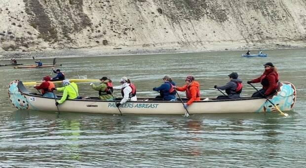 Paddlers Abreast is a team of breast cancer survivors and supporters that competes annually in the 715-kilometre Yukon River Quest. This year marks the team's 20th annniversary. (Chris MacIntyre/CBC - image credit)