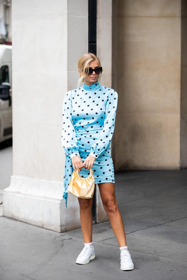 <p>Break out of the black-and-white mold, and embrace a brightly colored polka-dot dress. A colorful bag and sneakers are playfully casual additions.</p>
