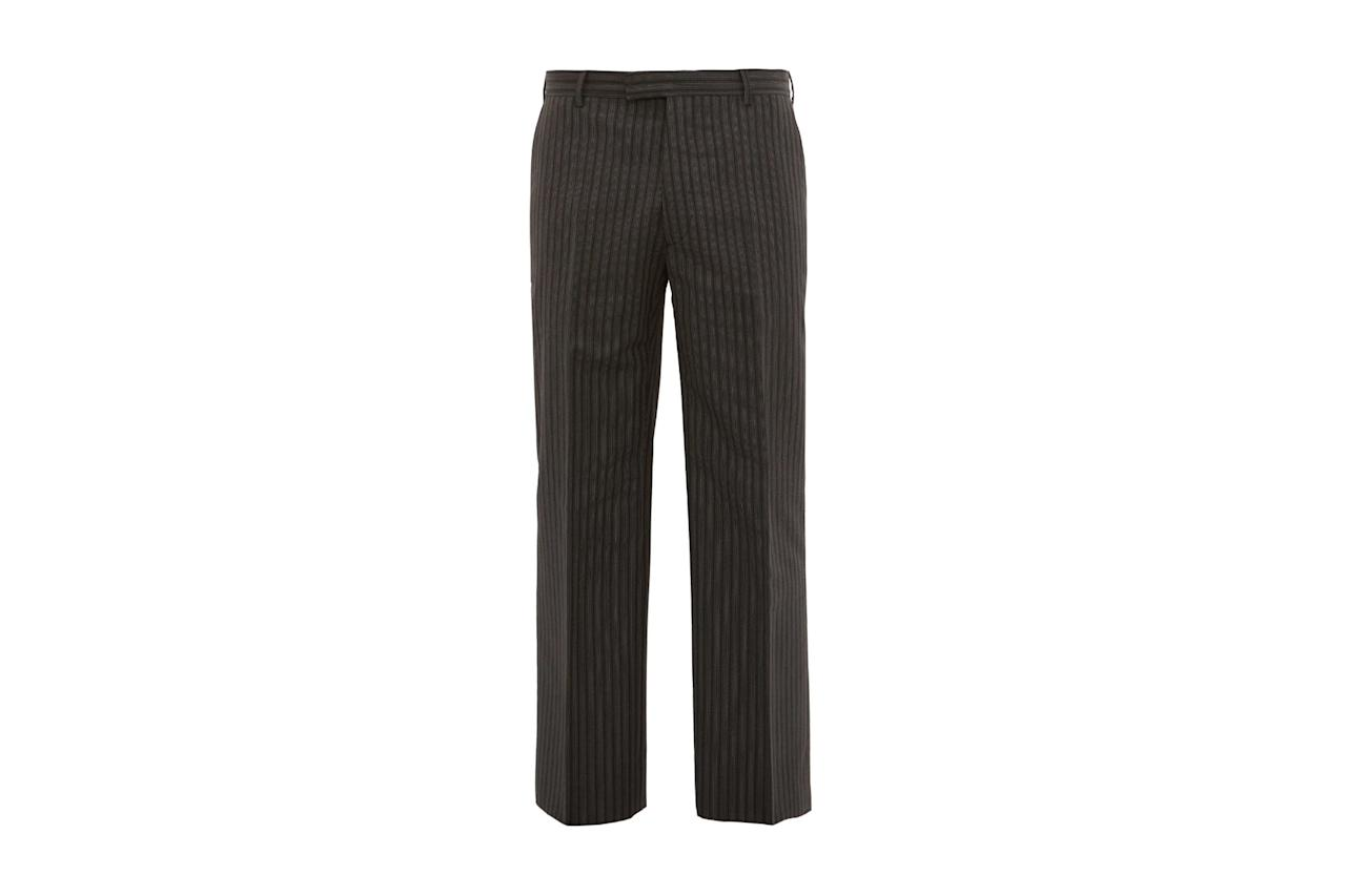 "$870, Matches. <a href=""https://www.matchesfashion.com/us/products/Prada-Pinstriped-straight-leg-trousers-1293034"">Get it now!</a>"