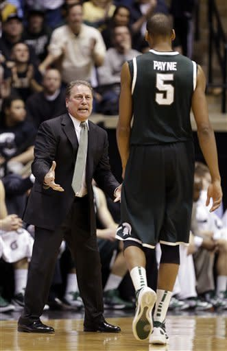 Michigan State coach Tom Izzo, left, questions center Adreian Payne as he comes off the court in the first half of an NCAA college basketball game against Purdue in West Lafayette, Ind., Saturday, Feb. 9, 2013. (AP Photo/Michael Conroy)
