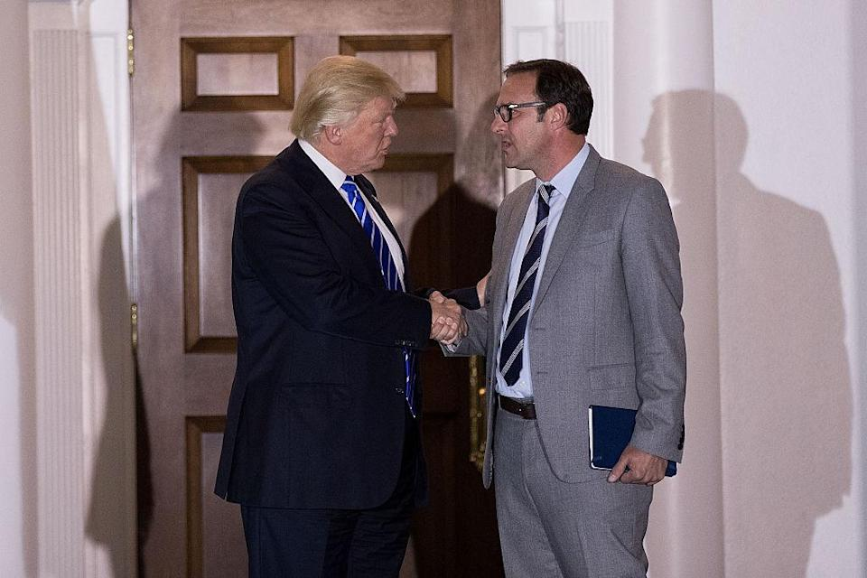 Donald Trump greets Cubs co-owner Todd Ricketts after a 2016 meeting at Trump International Golf Club. (Getty Images)